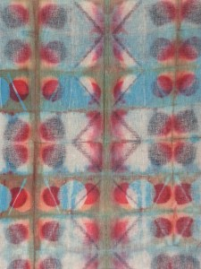 This shibori-clamped fabric was discharged three times and dyed three times.