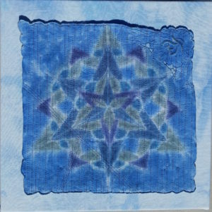 Northern Lights, by Mary Vaneecke.  18'' x 18''  Hand-dyed vintage linen napkin, layered and stitched.  Stretched on a frame.